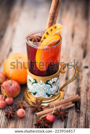 Hot red mulled wine with christmas spices, orange slice, anise and cinnamon sticks