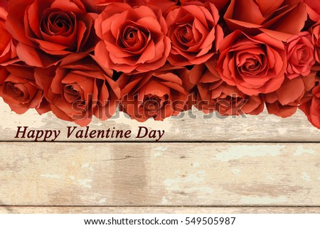 "hot red paper rose on old wooden background with "" Happy Valentine Day"" word"