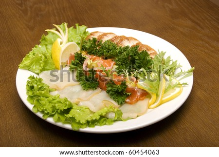 Hot roasted grilled fish with parsley decoration on white plate