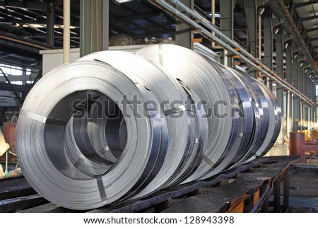 Hot rolled strip steel products in a warehouse - stock photo
