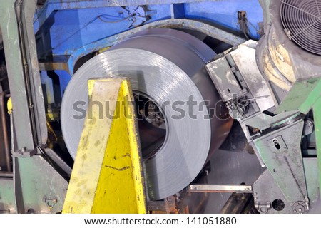 hot rolls of tinplate shoot in the plant, Cold rolled steel coils - stock photo