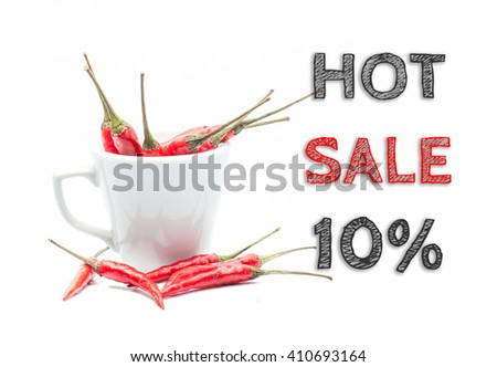 Hot Sale 10% words written on white background with cup of chillies - stock photo