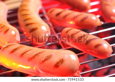 Hot sausages on barbecue