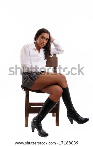 Hot schoolgirl posing isolated over white background - stock photo