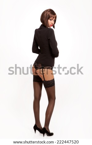 Hot secretary with sexy black lingerie and suit jacket. - stock photo