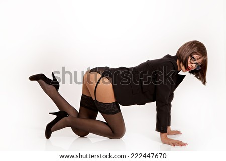 Hot secretary with sexy black lingerie and suit jacket in doggiestyle position. - stock photo