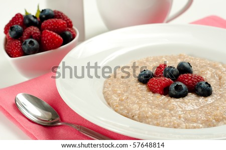 Hot Seven Grain  Cereal with Fresh Berries - stock photo