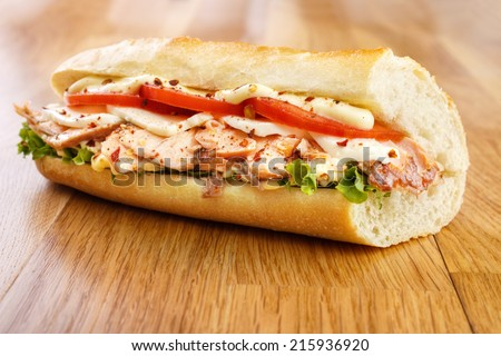 Hot smoked salmon sandwich with tomato , mozzarella cheese , lettuce and mayonnaise - stock photo