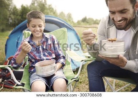 Hot soup after long day on camping - stock photo