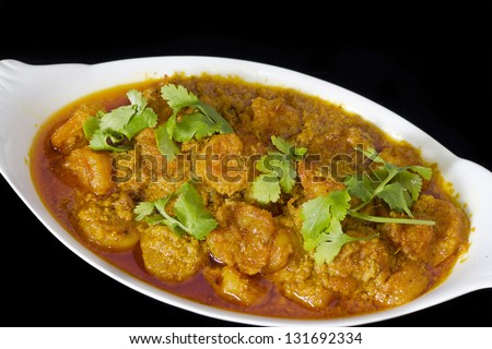 Hot spicy prawn curry - stock photo