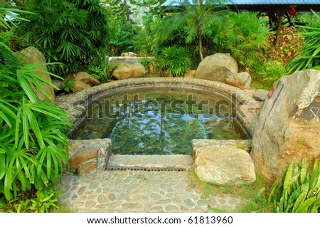 hot spring on a river with chinese gloriette - stock photo