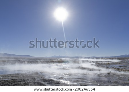 Hot springs in Uyuni salt desert. - stock photo