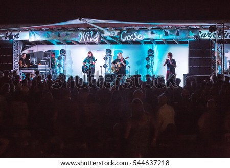 HOT SPRINGS, NC - JULY 9: Large crowd in front of stage watching the Indigo Girls play a song at the Wild Goose Festival on July 9, 2016 in Hot Springs, NC, USA.