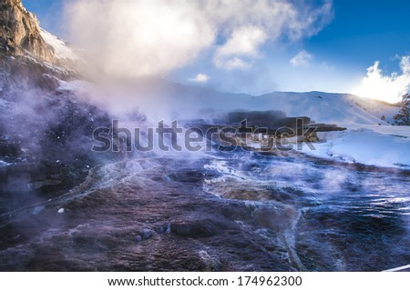 Hot steaming water beautiful cascade geyser - winter landscape in Yellowstone National Park - stock photo