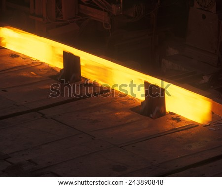 Hot steel being processed - stock photo