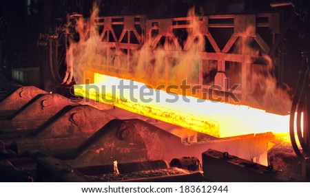 hot steel on conveyor in plant - stock photo