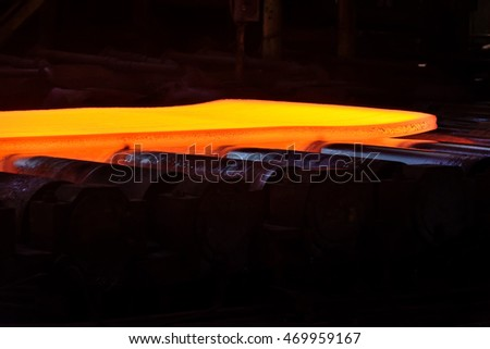 hot steel on conveyor in steel plant