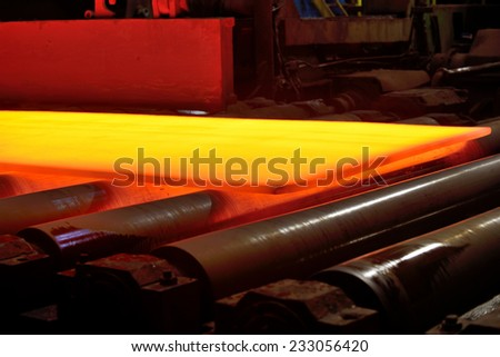 hot steel on conveyor, isolated, soft focus - stock photo