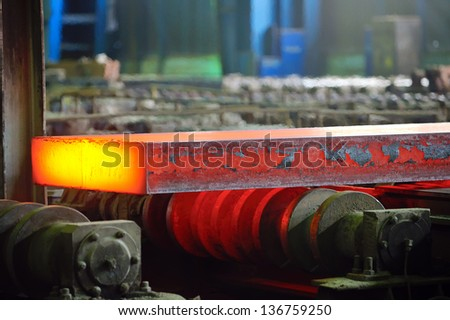 hot steel on conveyor; sheet metal - stock photo