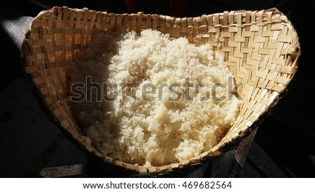 Hot sticky rice or glutinous rice in bamboo steamer (natural lighting)