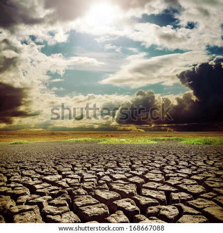hot sun over drought earth with cracks
