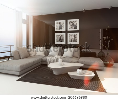 Hot sunny modern sitting room interior with sun flare through a large floor-to-ceiling window, art on the dark accent wall and a comfortable lounge suite - stock photo