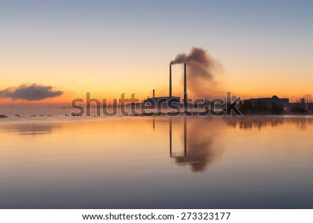 Hot sunset over the thermal power plant in winter