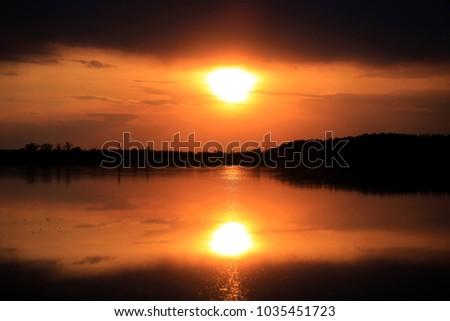 Hot sunset scene over lake water surface