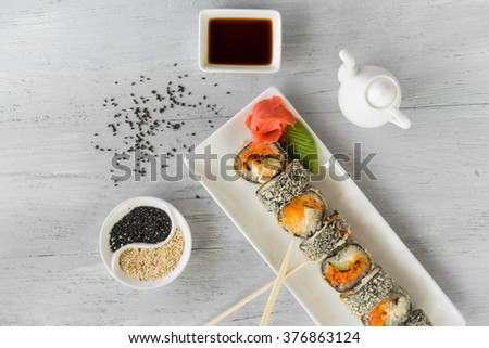 hot sushi rolls on a white table - stock photo