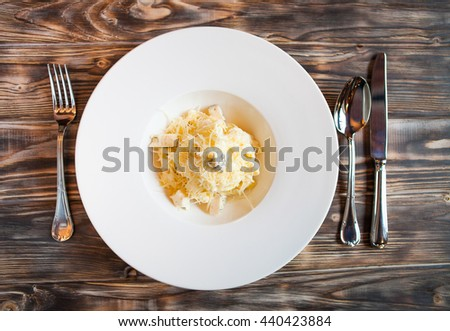 Hot tasty Italian paste with parmesan on a dark wooden background - stock photo