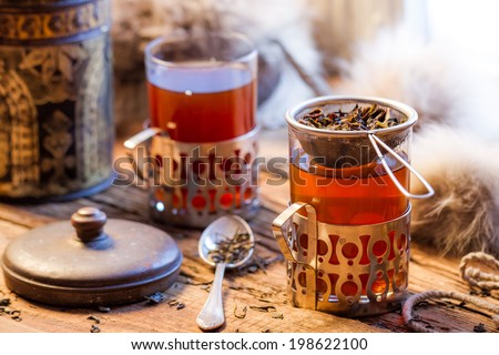 Hot tea brewed in the old style - stock photo