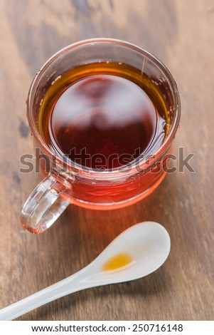 Hot tea brewed serve with in a glass cup.
