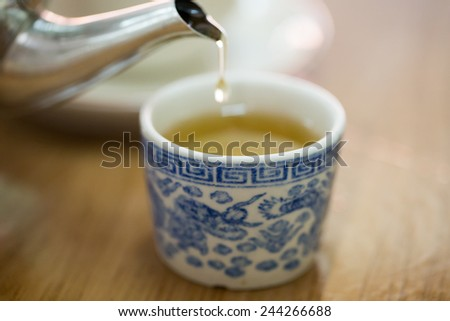 hot tea,Chinese traditional hot tea pouring from kettle - stock photo