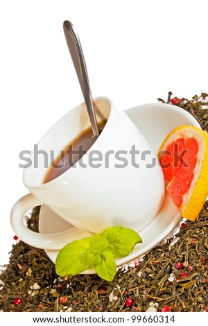 Hot tea cup with lime and fresh mint