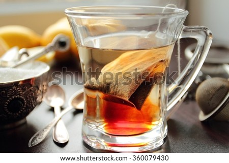 Hot tea cup with tea bag inside - stock photo