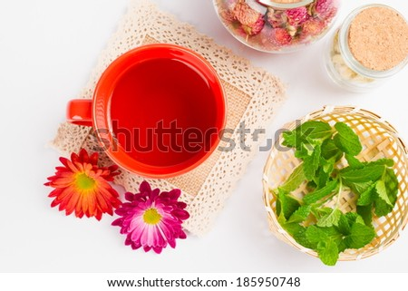 hot tea,flowers,mint on white background