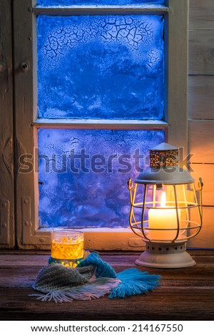 Hot tea in cold winter evening - stock photo
