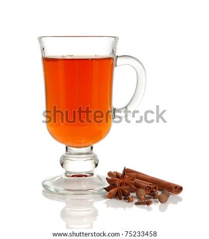 Hot tea in glass cup and spice on white background - stock photo