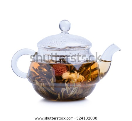 Hot tea in glass teapot isolated on white background - stock photo