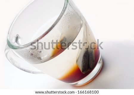 Hot tea in steamy glass cup - stock photo