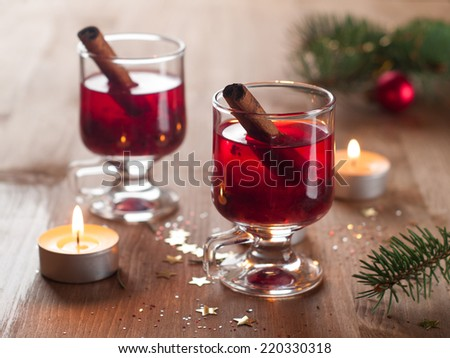 Hot tea or mulled wine with cinnamon stick, selective focus - stock photo