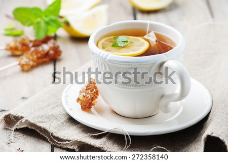 Hot tea with lemon and mint, selective focus