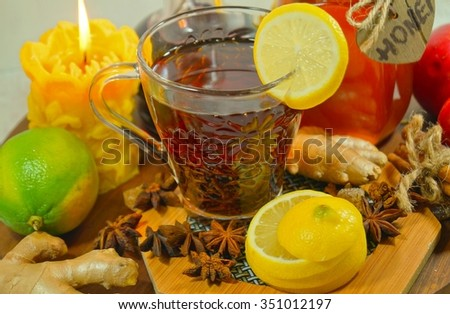 Hot tea with spices, honey and citrus  - an alternative to antibiotics - selective focus