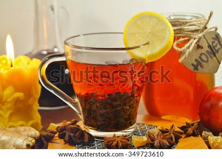 Hot tea with spices, honey and syrup - an alternative to antibiotics - selective focus