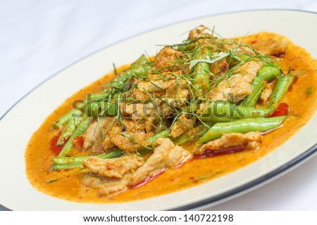 hot Thai red curry with Chicken with Green Beans and Kaffir lime leaves - stock photo