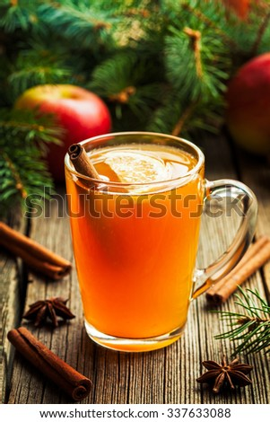 Hot toddy traditional winter alcohol warming drink recipe. Homemade christmas holiday aromatic beverage with spices.  Rustic style. - stock photo