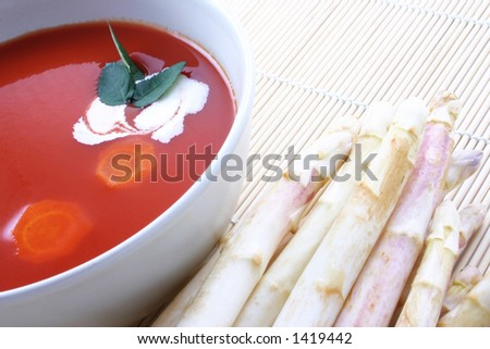 Hot Tomato Soup and Asparagus - stock photo