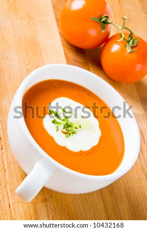 Hot tomato soup with cream and cress