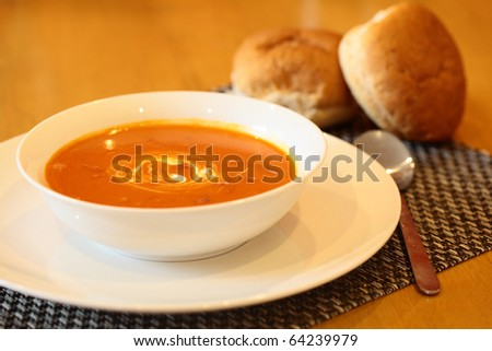 Hot Tomato Soup With Sour Cream In a Bowl with Spoon