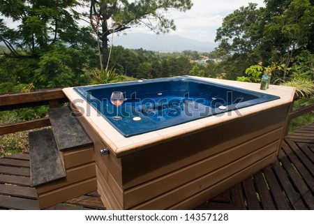 Hot tub with a view of the mountains - stock photo
